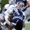 Edmond Memorial\'s Sam Kreutzer, top, and Tasden Ingram tackle Edmond North\'s Michael Farmer during the high school football game between Edmond North and Edmond Memorial at Wantland Stadium in Edmond, Okla., Friday, Aug. 31, 2012. Photo by Sarah Phipps, The Oklahoman