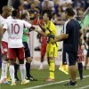 Photo - Columbus Crew's Bernardo Anor, center, talks to referee Ted Unkel after Anor was ejected from the game during the second half of an MLS soccer match, Saturday, July 12, 2014, in Harrison, N.J. The Red Bulls won 4-1. (AP Photo/Julio Cortez)