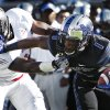 Photo - Memphis' Marquis Warford, right, stiff-arms Arkansas State' sChris Humes during the first half of an NCAA college football game at Liberty Bowl Memorial Stadium in Memphis, Tenn., Saturday, Sept. 21, 2013. (AP Photo/The Commercial Appeal, Mark Weber)
