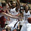 OU\'s Whitney Hand (25) passes the ball past Texas A&M\'s Karla Gilbert (34) and Tyra White (20) during the women\'s college basketball Big 12 Championship tournament game between the University of Oklahoma and Texas A&M in Kansas City, Mo., Friday, March 11, 2011. Photo by Bryan Terry, The Oklahoman