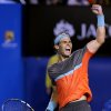 Rafael Nadal of Spain celebrates after defeating Roger Federer of Switzerland during their semifinal at the Australian Open tennis championship in Melbourne, Australia, Friday, Jan. 24, 2014.(AP Photo/Aaron Favila)