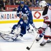 Toronto Maple Leafs goaltender James Reimer makes a save on New Jersey Devils left wing Patrik Elias (26) during the third period of their NHL hockey game, Monday, March 4, 2013, in Toronto. The Maple Leafs won 4-2. (AP Photo/The Canadian Press, Frank Gunn)