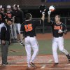 Photo - Oregon State's Dylan Davis (10) celebrates his go-ahead home run with teammate Gabe Clark (16) to put the Beavers ahead of North Dakota State an NCAA college baseball regional tournament game in Corvallis, Ore., Friday, May 30, 2014. (AP Photo/Mark Ylen)