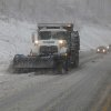 Snow plows thunder through the mountains of West Virginia as the superstorm begins it\'s raking of the region, Monday evening, Oct. 29, 2012. In the higher elevations of the mountains there could be from 2-3 feet of snow and blizzard conditions thru Tuesday. (AP Photo/Robert Ray) ORG XMIT: WVRR101