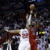 Photo - Miami Heat's LeBron James (6) shoots over Los Angeles Clippers' Matt Barnes (22) during the first half of an NBA basketball game in Miami, Friday, Feb. 8, 2013. (AP Photo/Alan Diaz)