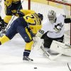 Photo - Pittsburgh Penguins goalie Marc-Andre Fleury (29) blocks a shot by Nashville Predators forward Patric Hornqvist (27), of Sweden, in the first period of an NHL hockey game Tuesday, March 4, 2014, in Nashville, Tenn. (AP Photo/Mark Humphrey)