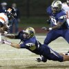 Norman\'s Imond Robinson misses Southmoore\'s Cory Keyes tackle during the first half in Moore, Friday October 12, 2012. Photo By Steve Gooch, The Oklahoman