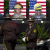 Photographs of the 19 fallen firefighters are displayed before the