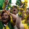 Photo - Brazil fans celebrate after their team scored a goal during a penalty shootout after regulation time during the World Cup round of 16 soccer match between Brazil and Chile at the FIFA Fan Fest in Sao Paulo, Brazil, Saturday, June 28, 2014.(AP Photo/Rodrigo Abd)