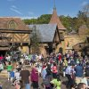 This image released by Disney shows people outside of Gaston\'s Tavern, inspired by Disney\'s animated film