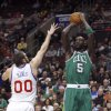 Boston Celtics\' Kevin Garnett (5) shoots over Philadelphia 76ers\' Spencer Hawes (00) in the first half of an NBA basketball game, Tuesday, March 5, 2013, in Philadelphia. (AP Photo/H. Rumph Jr)