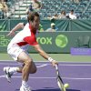 Photo - Richard Gasquet, of France, returns a shot to Olivier Rochus, of Belgium, during the Sony Open tennis tournament in Key Biscayne, Fla.,  Saturday, March 23, 2013. (AP Photo/Alan Diaz)