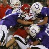 Washington\'s Robert Rhynes, center, is stopped by the Bethany defense including Blake Collins (33), Kyle Murray (52) and John Page, right, during their high school football game in Bethany, Okla., on Friday, September 16, 2011. Photo by John Clanton, The Oklahoman