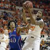 Oklahoma State \'s Michael Cobbins (20) and Kansas\' Kevin Young (40) battle for a rebound during the college basketball game between the Oklahoma State University Cowboys (OSU) and the University of Kanas Jayhawks (KU) at Gallagher-Iba Arena on Wednesday, Feb. 20, 2013, in Stillwater, Okla. Photo by Chris Landsberger, The Oklahoman