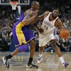Oklahoma Xity\'s James Harden (13) reacts after being fouled by Kobe Bryant (24) of Los Angeles during the NBA basketball game between the Los Angeles Lakers and the Oklahoma City Thunder at the Ford Center in Oklahoma City, Friday, March 26, 2010. Photo by Nate Billings, The Oklahoman
