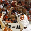 Oklahoma State\'s Marcus Smart (33) shoots against Javan Felix (3) during a men\'s college basketball game between Oklahoma State University (OSU) and the University of Texas at Gallagher-Iba Arena in Stillwater, Okla., Saturday, March 2, 2013. Photo by Nate Billings, The Oklahoman