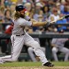 Photo - Washington Nationals' Jayson Werth swings on a home run against the Seattle Mariners in the third inning of a baseball game Friday, Aug. 29, 2014, in Seattle. (AP Photo/Elaine Thompson)