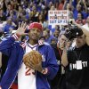 Photo -   Former Philadelphia 76er Allen Iverson acknowledges the crowd as he brings in the game ball before Game 6 of an NBA basketball Eastern Conference semifinal playoff series between the 76ers and the Boston Celtics, Wednesday, May 23, 2012, in Philadelphia. (AP Photo/Matt Slocum)