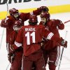 Phoenix Coyotes left wing Taylor Pyatt (14) celebrates his goal with Martin Hanzal (11), Radim Vrbata, center, and Keith Yandle (3) during the first period of Game 5 of the NHL hockey Stanley Cup Western Conference finals, Tuesday, May 22, 2012, in Glendale, Ariz. (AP Photo/Ross D. Franklin)