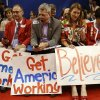 Kansas delegates, from left, Randy Duncan from Brookville, Clay Barker from Leawood, Amanda Adkins from Kansas City and Helen Van Etten from Topeka read their smart phone during the Republican National Convention in Tampa, Fla., on Thursday, Aug. 30, 2012. (AP Photo/David Goldman) ORG XMIT: RNC741