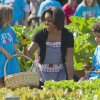 FILE - In this June 3, 2011, file photo, first lady Michelle Obama tends the White House garden in Washington, with a group of children as part of the