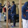 Photo - Detroit Tigers' Justin Verlander, center left, talks with Miguel Cabrera, center right, as Tigers players gather outside their locker room while waiting for an exhibition spring training baseball game between the Tigers and the Philadelphia Phillies to be called due to rain in Lakeland, Fla., Thursday, March 6, 2014. (AP Photo/Gene J. Puskar)