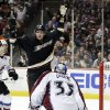 Photo - Anaheim Ducks right wing Corey Perry, rear, celebrates his goal past Colorado Avalanche goalie Jean-Sebastien Giguere during the second period of an NHL hockey game in Anaheim, Calif., Sunday, Feb. 24, 2013. (AP Photo/Chris Carlson)