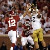 Notre Dame \'s Dan Fox (48) puts pressure on OU\'s Landry Jones (12) during the college football game between the University of Oklahoma Sooners (OU) and the Notre Dame Fighting Irish at the Gaylord Family-Oklahoma Memorial Stadium on Saturday, Oct. 27, 2012, in Norman, Okla. Photo by Chris Landsberger, The Oklahoman