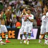 Photo - Iranian players applaud the crowd after the group F World Cup soccer match between Iran and Nigeria at the Arena da Baixada in Curitiba, Brazil, Monday, June 16, 2014. The match ended in a 0-0 draw.   (AP Photo/Martin Meissner)