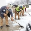 City workers clear the sidewalks in downtown Edmond, Friday , January 29, 2010. Photo by David McDaniel, The Oklahoman