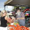 Celeste Poorman purchases tomatoes from Jim Wilson at the Farmer\'s Market in Edmond, OK, Saturday, Aug. 20, 2011. By Paul Hellstern, The Oklahoman