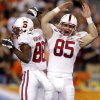 Stanford wide receiver Ty Montgomery (88) celebrates his touchdown with teammate Ryan Hewitt (85) during the first half of the Fiesta Bowl NCAA college football game Monday, Jan. 2, 2012, in Glendale, Ariz. (AP Photo/Paul Connors)
