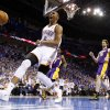 Oklahoma City\'s Russell Westbrook (0) celebrates after a dunk in front of Los Angeles\' Pau Gasol (16) during Game 2 in the second round of the NBA playoffs between the Oklahoma City Thunder and L.A. Lakers at Chesapeake Energy Arena in Oklahoma City, Wednesday, May 16, 2012. Photo by Bryan Terry, The Oklahoman