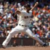 Photo - San Francisco Giants pitcher Madison Bumgarner throws to the Los Angeles Dodgers during the first inning of a baseball game in San Francisco, Saturday, July 6, 2013. (AP Photo/George Nikitin)