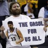 A Memphis Grizzlies fan holds a Marc Gasol poster during the first half of Game 4 between the Grizzlies and the Oklahoma City Thunder in a second-round NBA basketball series Monday, May 9, 2011, in Memphis, Tenn. (AP Photo/Wade Payne)
