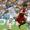 Photo - Belgium's Axel Witsel (6) is tripped by Russia's Denis Glushakov (8) during the group H World Cup soccer match between Belgium and Russia at the Maracana Stadium in Rio de Janeiro, Brazil, Sunday, June 22, 2014. (AP Photo/Natacha Pisarenko)