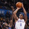 Oklahoma City\'s\' Russell Westbrook shoots the ball beside Dallas\' Dominique Jones (20) during a preseason NBA game between the Oklahoma City Thunder and the Dallas Mavericks at Chesapeake Energy Arena in Oklahoma City, Tuesday, Dec. 20, 2011. Photo by Bryan Terry, The Oklahoman