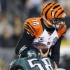 Cincinnati Bengals\' Andy Dalton, top, is sacked by Philadelphia Eagles\' Trent Cole in the first half of an NFL football game, Thursday, Dec. 13, 2012, in Philadelphia. (AP Photo/Michael Perez)