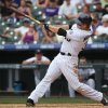 Photo - Colorado Rockies' Justin Morneau connects for a two-run, walkoff home run against the San Diego Padres in the 10th inning of the Rockies' 8-6 victory in 10 innings of a baseball game in Denver on Sunday, May 18, 2014. (AP Photo/David Zalubowski)