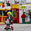 A Shriner clown uses a scooter to make his way through the fair at the Oklahoma State Fair at State Fair Park on Friday, Sept. 14, 2012, in Oklahoma City, Oklahoma. Photo by Chris Landsberger, The Oklahoman