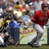 Photo - Los Angeles Angels' J.B. Shuck, right, hits a three run-scoring double during the seventh inning of a baseball game against the Milwaukee Brewers, Sunday, Sept. 1, 2013, in Milwaukee. (AP Photo/Morry Gash)