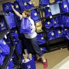 Photo - Chief Programs Officer Robyn Hilger gathers bags of school supplies being picked up for an elementary school at the Foundation for Oklahoma City Public Schools. The foundation, through its Teachers Warehouse program, recently reached the $1 million mark for giving away school supplies. Photo by Nate Billings, The Oklahoman  NATE BILLINGS - THE OKLAHOMAN