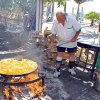 Photo - At Nerja, on Spain's Costa del Sol, there's a lunchtime seaside feast every day at Ayo's bar, where he cooks paella over an open fire. (Photo by Rick Steves)