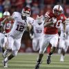 Nebraska\'s Roy Helu Jr. rushes up field as OU\'s Austin Box (12) chases him down during the first half of the college football game between the University of Oklahoma Sooners (OU) and the University of Nebraska Cornhuskers (NU) on Saturday, Nov. 7, 2009, in Lincoln, Neb. Photo by Sarah Phipps, The Oklahoman