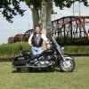 """Steve Barber of Bethany is a member of the Star Chapter 378 Touring and Riding Motorcycle Association of north OKC. Pictured here posing for our very first portrait photo shoot with the historic steel cantilever bridge on a part of old Route 66, the Mother Road of the 50\'s. Located at Lake Overholser, the bridge provided the perfect background for our ride theme, """"Its not the destination that counts, It\'s the journey"""". A ride to Guthrie for lunch followed the photo shoot, then a ride to Arcadia for a photo session at the Red Barn, also on Route 66. Community Photo By: Garry Baird Submitted By: Garry, Oklahoma City"""