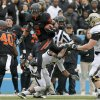 Oklahoma State\'s Josh Stewart (5) leaps over Purdue\'s Frankie Williams (2) during the Heart of Dallas Bowl football game between Oklahoma State University and Purdue University at the Cotton Bowl in Dallas, Tuesday, Jan. 1, 2013. Oklahoma State won 58-14. Photo by Bryan Terry, The Oklahoman