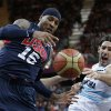 Photo -   USA's Carmelo Anthony (15) and Argentina's Luis Scola, right, scramble for the ballduring a preliminary men's basketball game at the 2012 Summer Olympics, Monday, Aug. 6, 2012, in London. (AP Photo/Eric Gay)