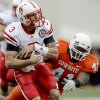 Nebraska\'s Taylor Martinez runs in front of OSU\'s Orie Lemon during the college football game between the Oklahoma State Cowboys (OSU) and the Nebraska Huskers (NU) at Boone Pickens Stadium in Stillwater, Okla., Saturday, Oct. 23, 2010. Photo by Bryan Terry, The Oklahoman