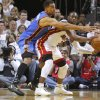 Oklahoma City\'s Thabo Sefolosha (2) defends Miami\'s Dwyane Wade (3) during Game 4 of the NBA Finals between the Oklahoma City Thunder and the Miami Heat at American Airlines Arena, Tuesday, June 19, 2012. Photo by Bryan Terry, The Oklahoman