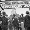 """Photo - FILE -In this July 14, 1969 file photo, banners of appreciation from the Vietnamese decorate the dock at Danang, Vietnam, where a farewell ceremony was held by the Vietnamese Government for departing Marines of the 1st Battalion/9th Regiment. The Marine Corps is holding a deactivation ceremony on Friday, Aug. 29, 2014, for the 1st Battalion, 9th Marine Regiment, 2nd Marine Division, a battalion nicknamed the """"Walking Dead."""" (AP Photo/File)"""